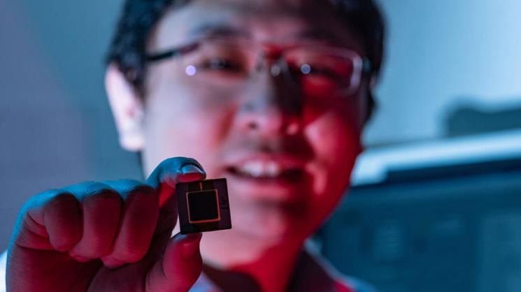 Rice University integrated circuit designer Kaiyuan Yang with a prototype of a new device that is 10 times more reliable than current methods of producing unclonable digital fingerprints for Internet of Things (IoT) devices. (Photo by Jeff Fitlow/Rice)