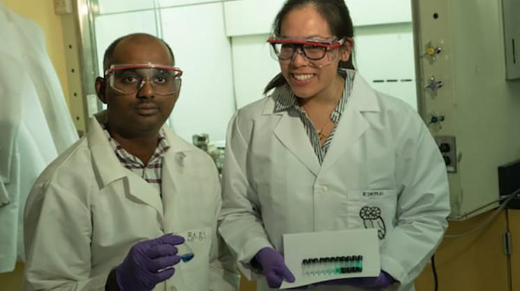 Rice University research scientist Babu Ganguli and graduate student Kimmai Tran show test tubes with their eutectic solvent and varying concentrations of cobalt drawn into the solution.