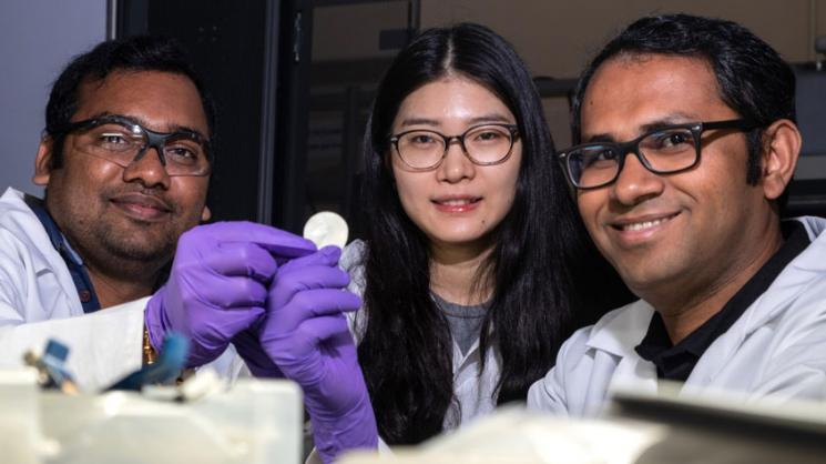 From left, postdoctoral researcher Anand Puthirath, academic visitor Fanshu Yuan and research scientist M.M. Rahman show the high-temperature flexible dielectric material invented at Rice University. The three are among authors of a paper in Advanced Func