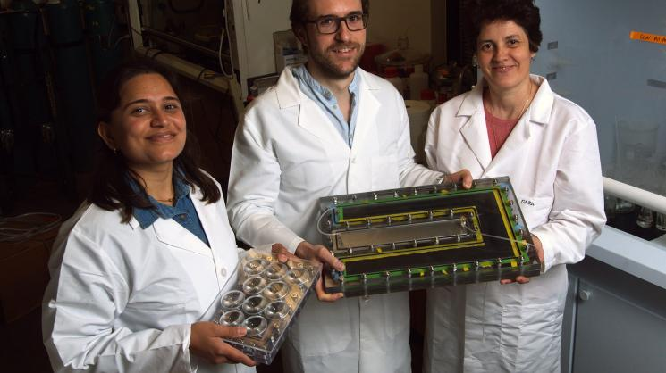 "Rice University researchers (from left) Pratiksha Dongare, Alessandro Alabastri and Oara Neumann showed that Rice's ""nanophotonics-enabled solar membrane distillation"" (NESMD) system was more efficient when the size of the device was scaled up and light w"